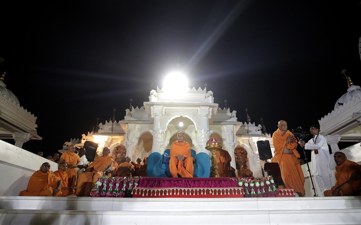 Swamishri on the mandir podium during the welcome assembly