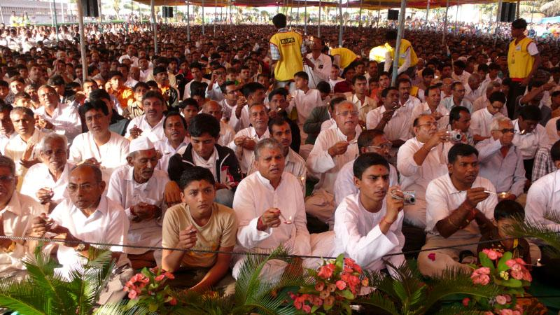 Devotees perform arti