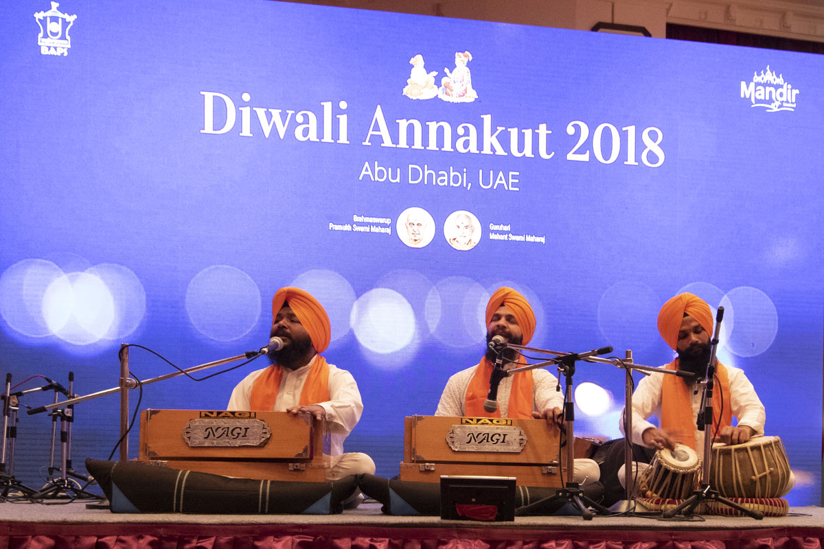 Devotees of the Sikh community sing devotional songs
