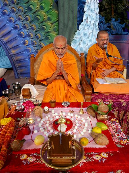 Prior to Swamishri's morning puja Pujya Mahant Swami is engaged in diksha rituals of parshads and sadhaks