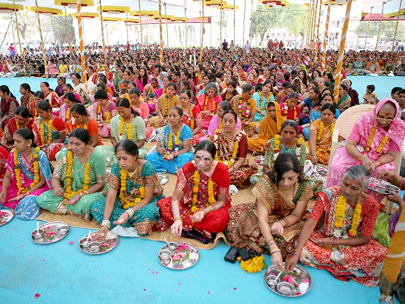 Mothers of sadhaks engaged in rituals