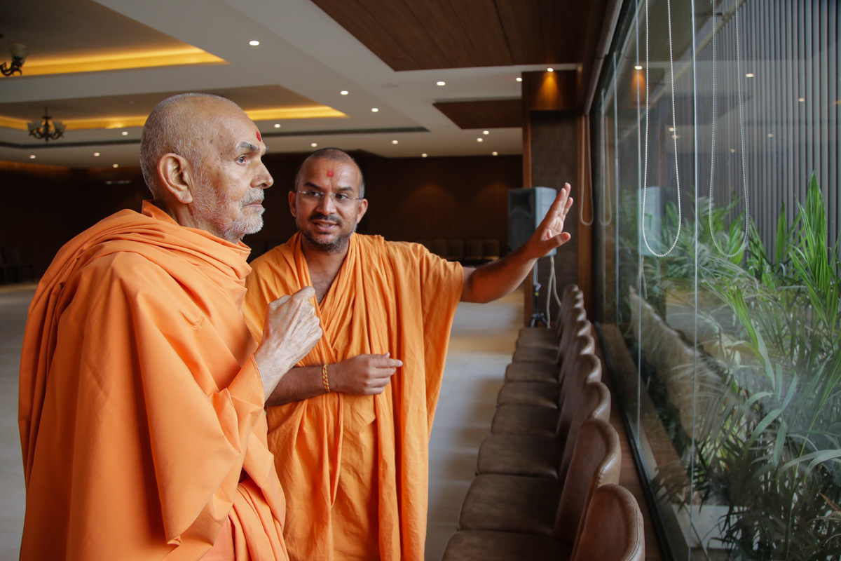 Swamishri observes 'Swaminarayan Nagar': venue of HH Pramukh Swami Maharaj's 98th birthday celebration, from the window