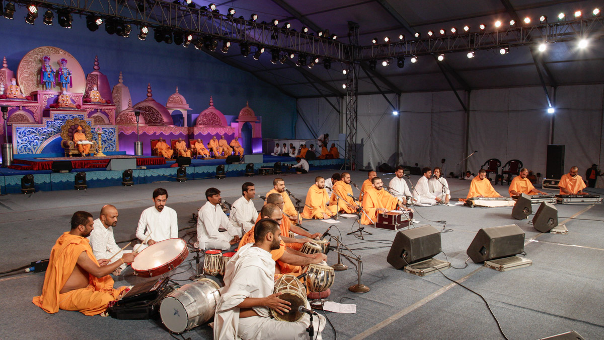 Sadhus and youths present kirtan aradhana in the evening satsang assembly