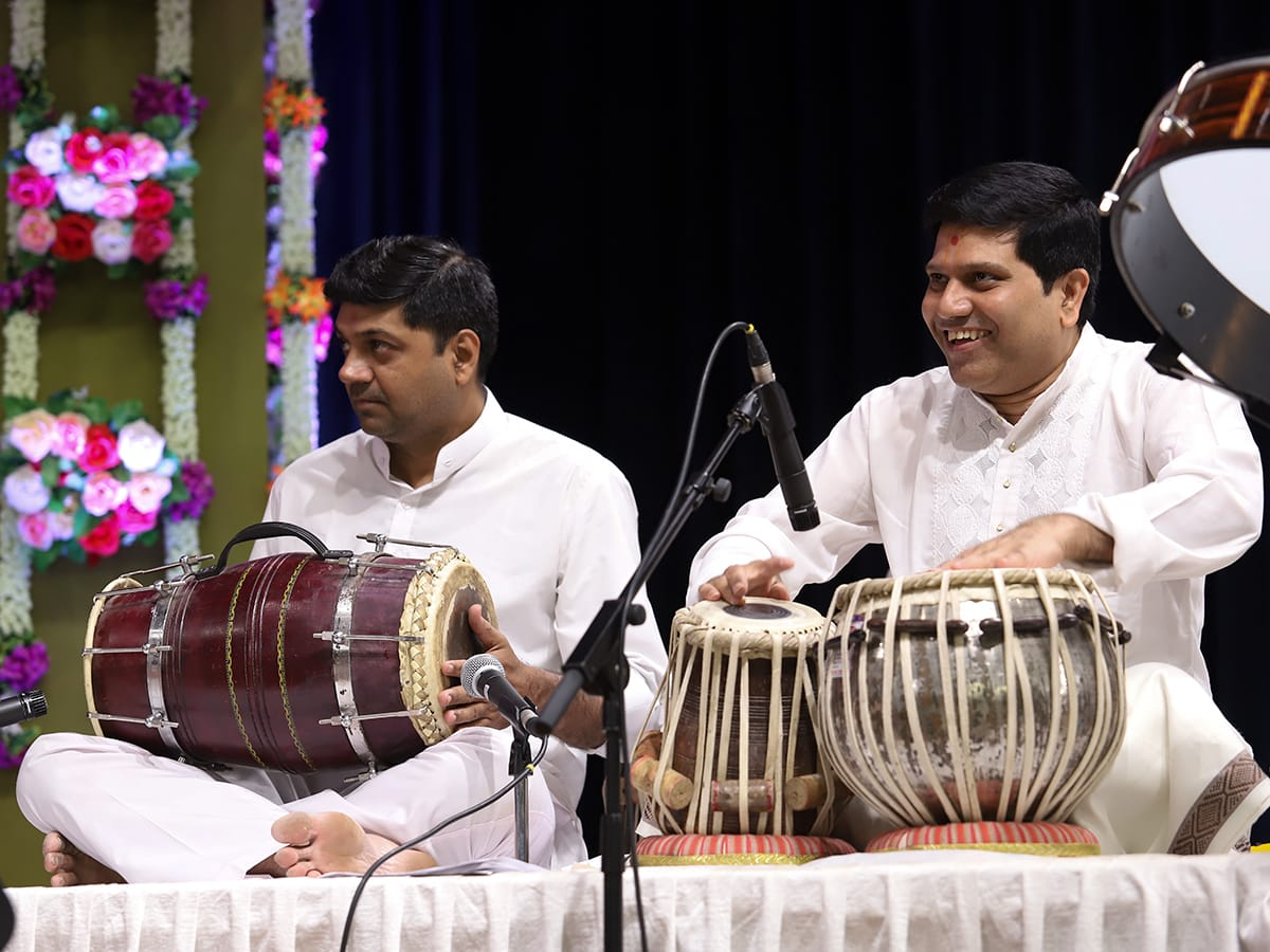 Youths play instruments during the kirtan aradhana