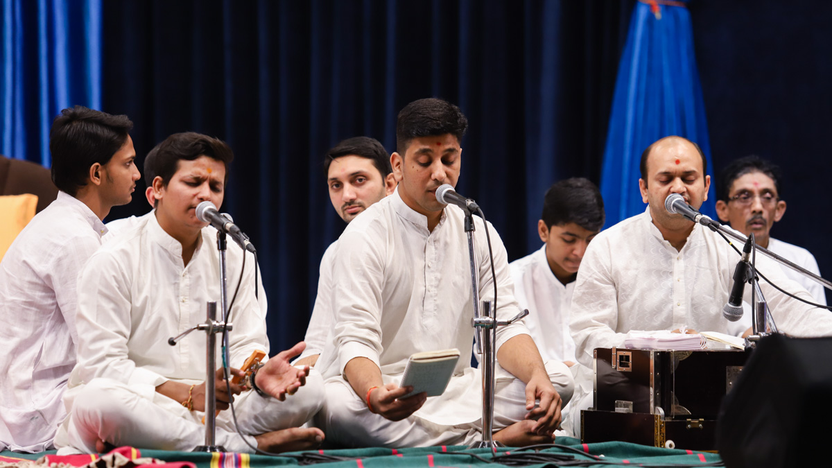 Youths sing kirtans in the evening Youth Upliftment Forum assembly