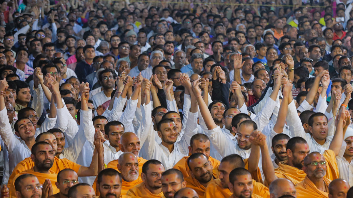 Sadhus and devotees join hands to symbolize unity