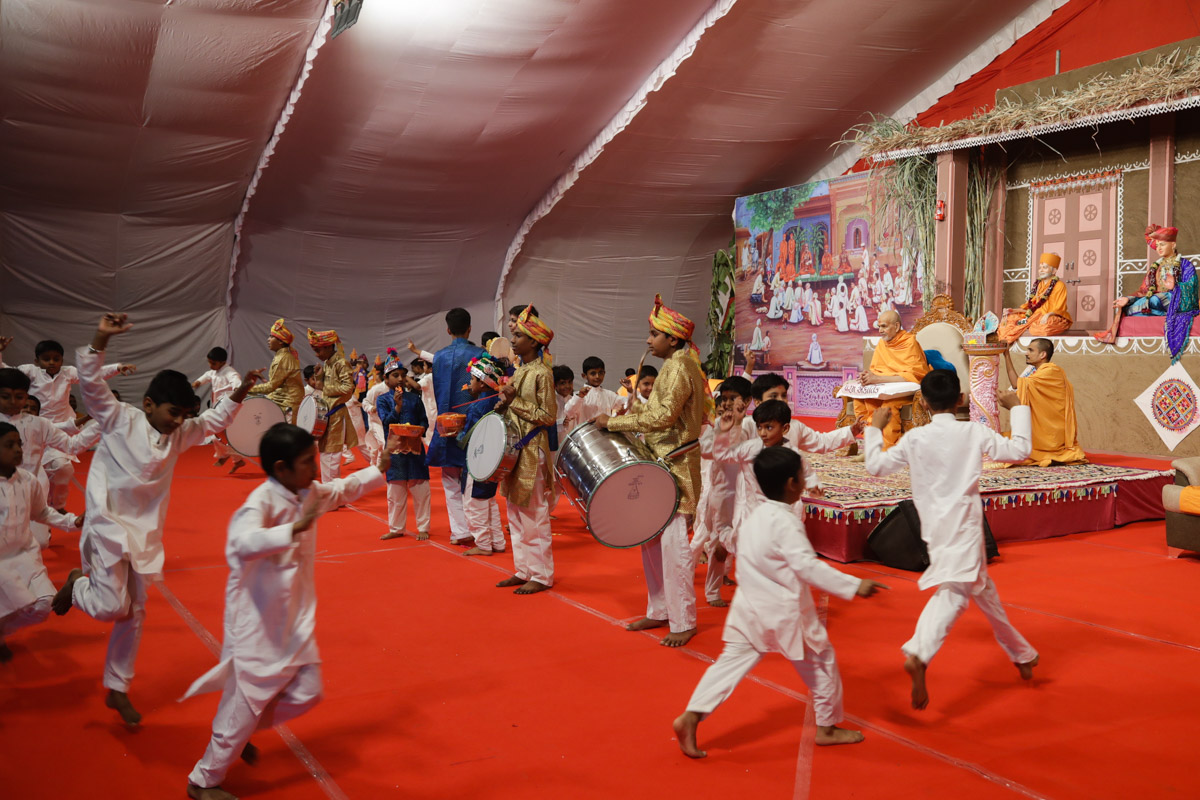Children perform a welcome dance