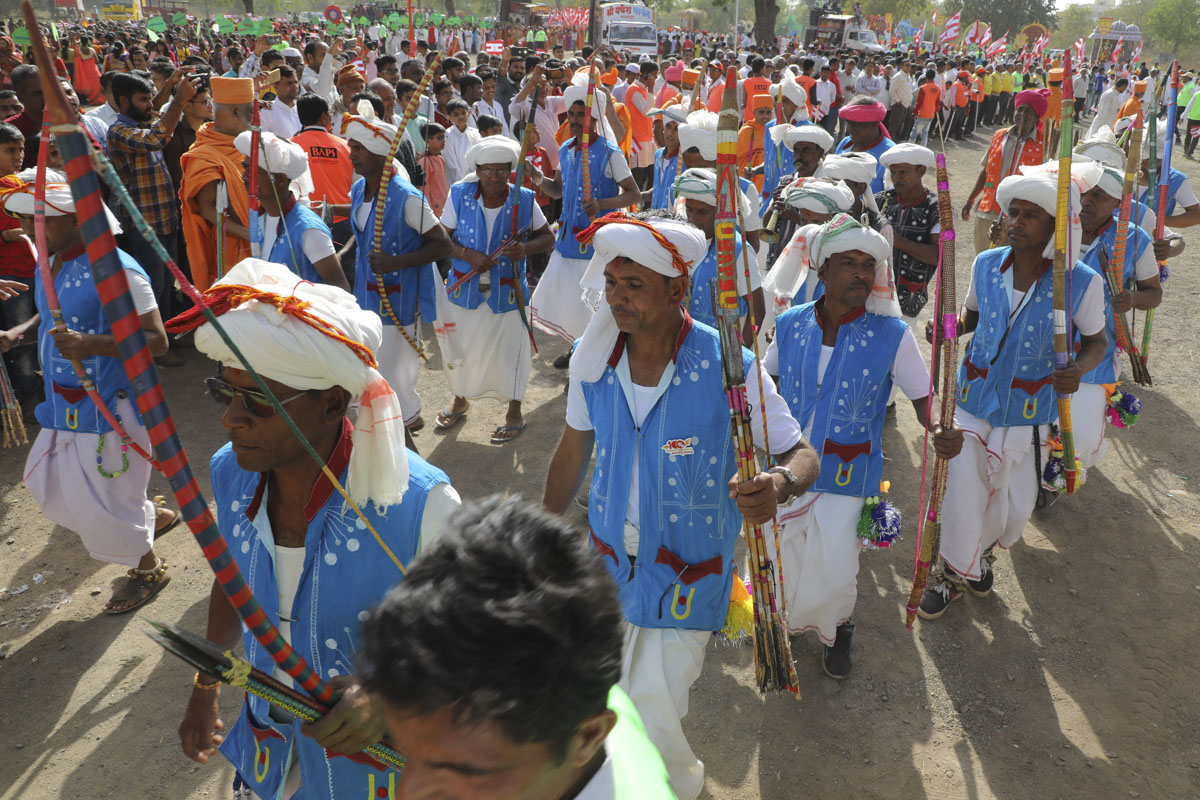 Tribal devotees from the region participate in the procession