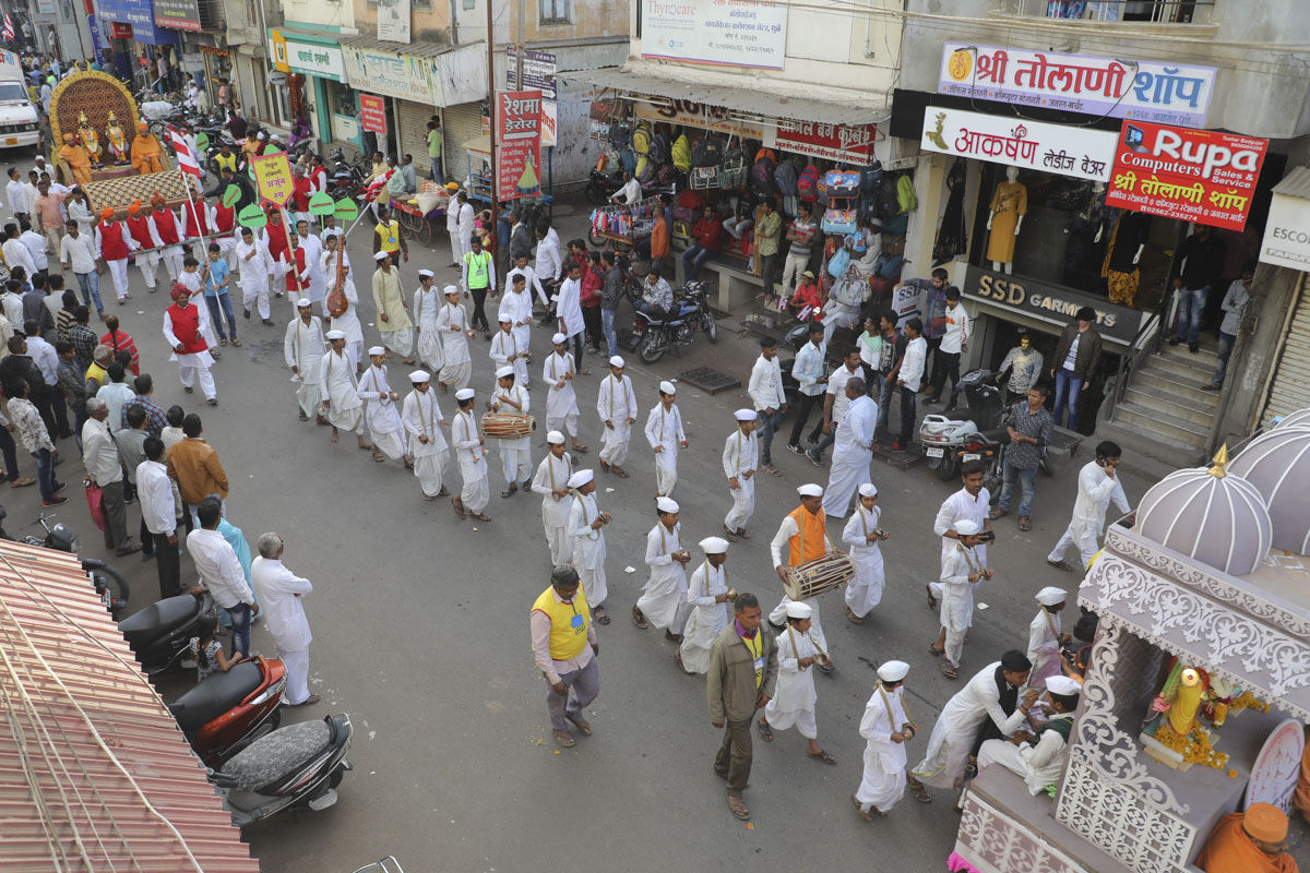 Sadhus and devotees during the procession