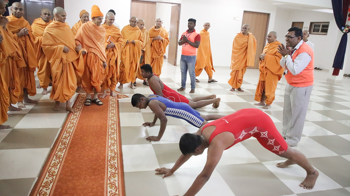 Youths perform yoga postures