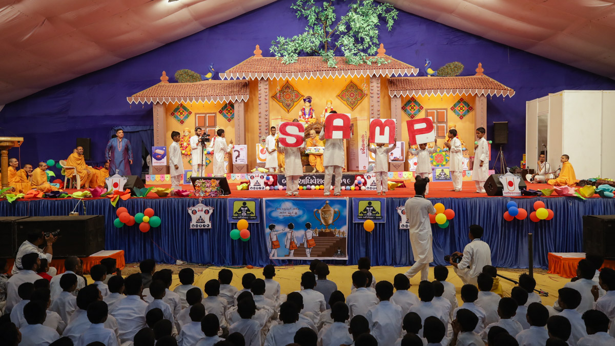 Children perform during the Bal Din assembly