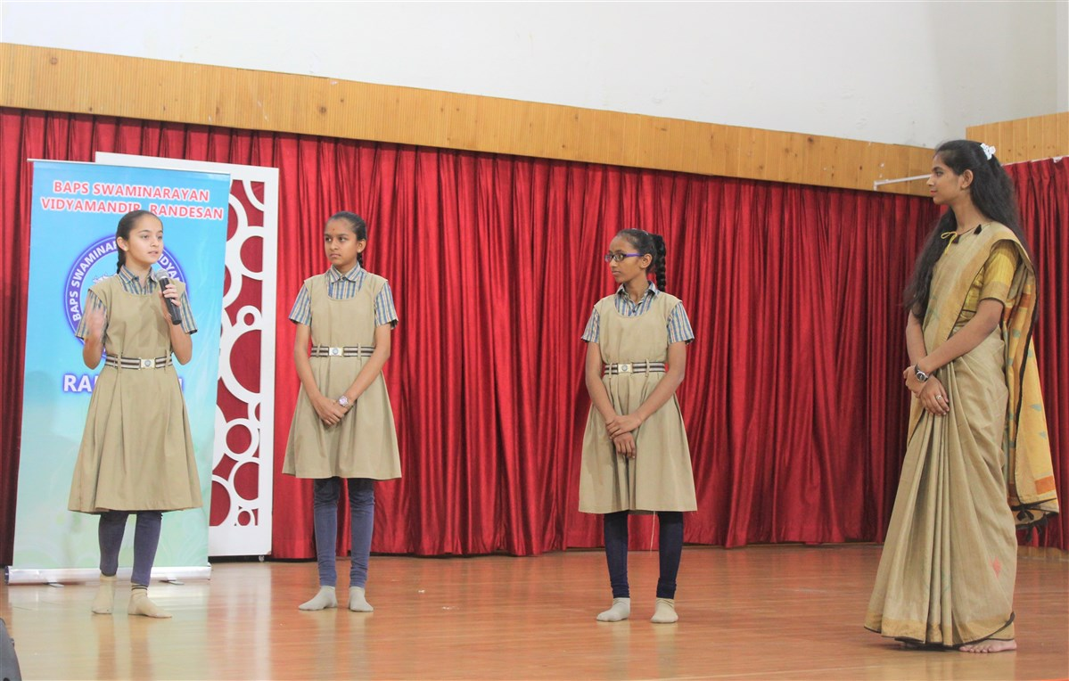 Students performing various programs on occasion of IWD 2019
