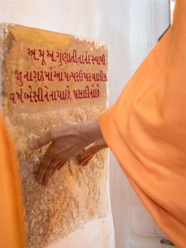 Swamishri reverentially touches a sacred stone