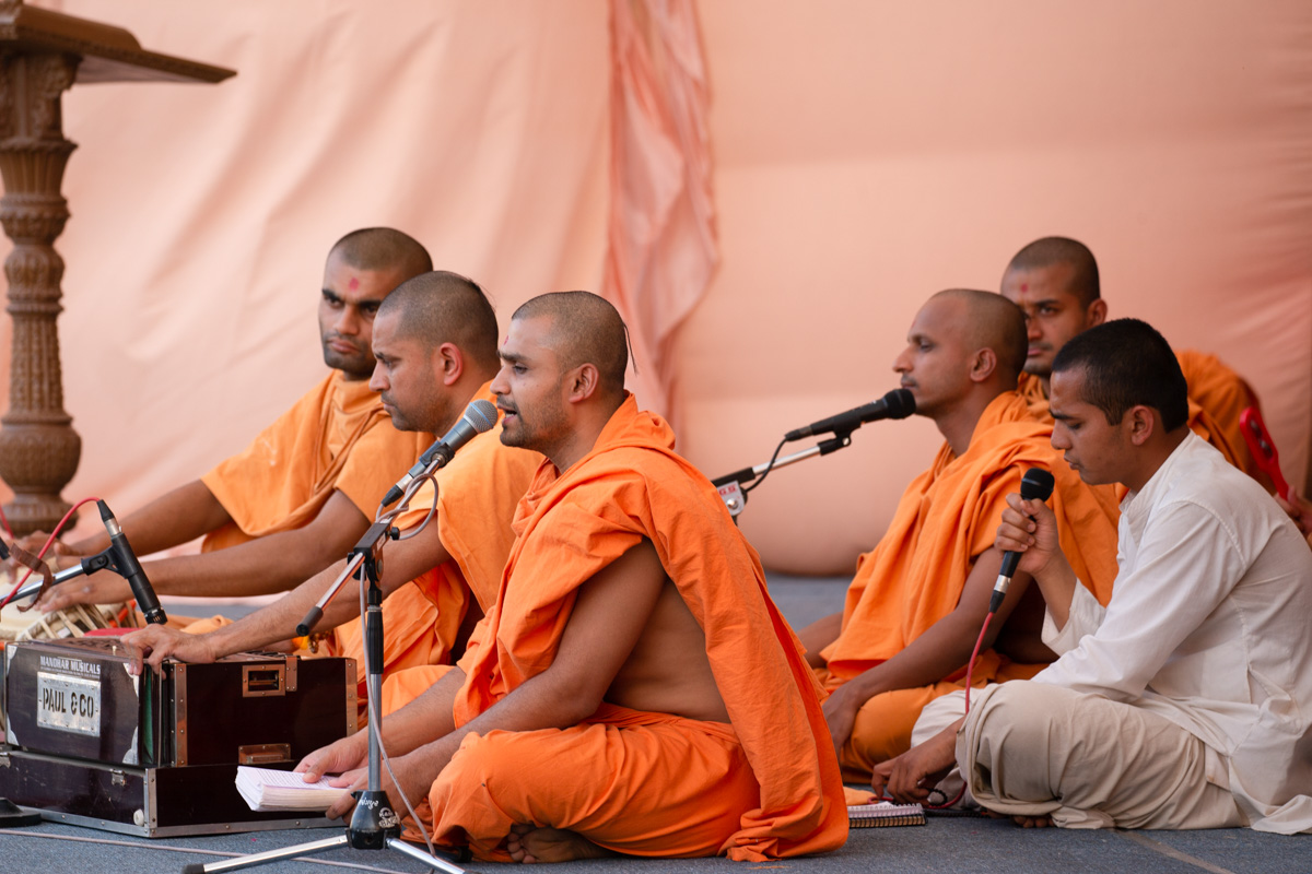 Sadhus sing kirtans in the evening Sunday satsang assembly