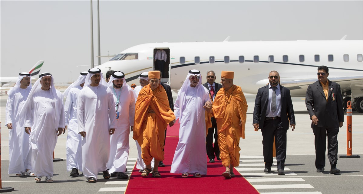 HE Sheikh Nahyan Mabarak Al Nahyan escorts Swamishri towards the airport terminal