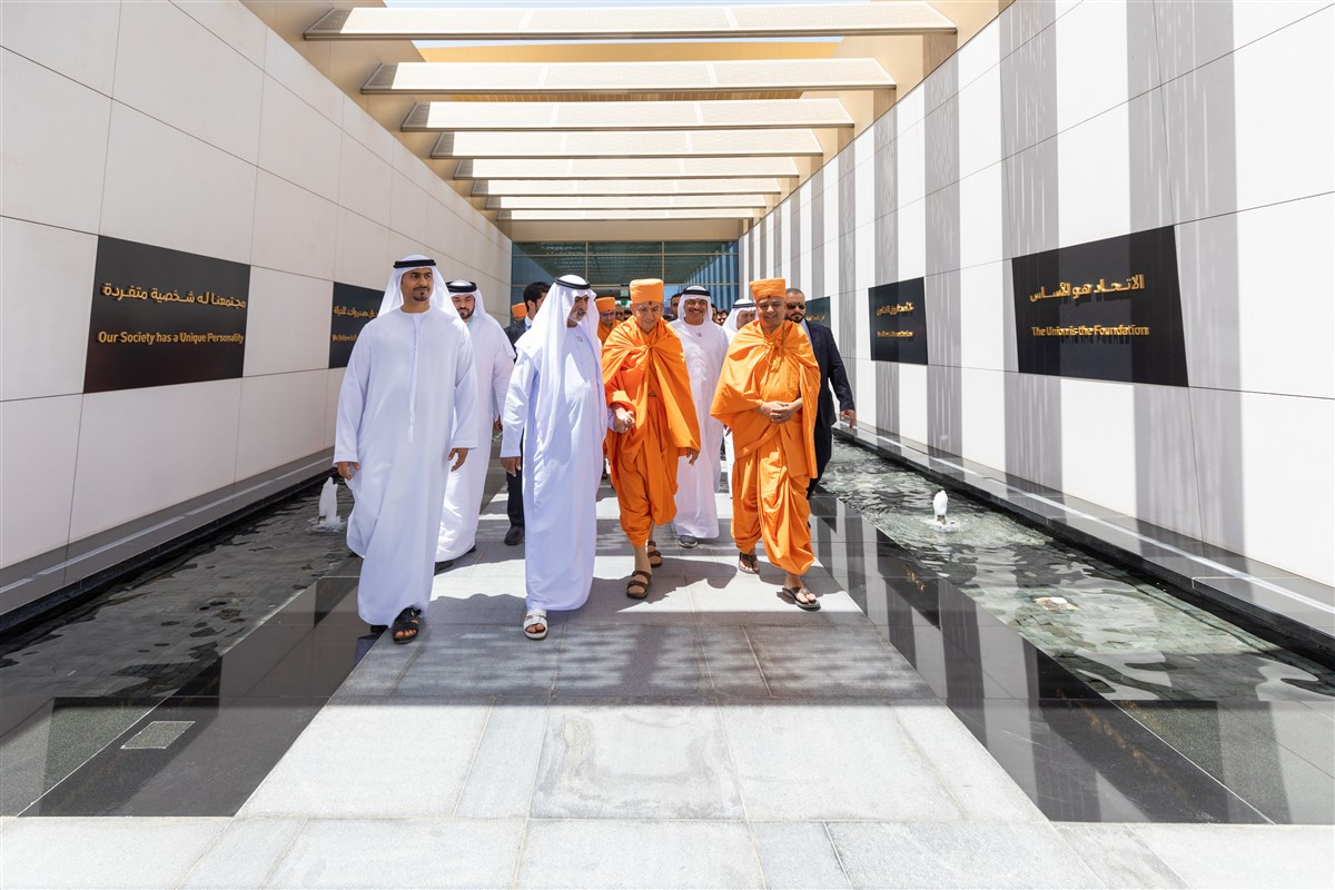 HE Sheikh Nahyan Mabarak Al Nahyan accompanies Swamishri towards his car