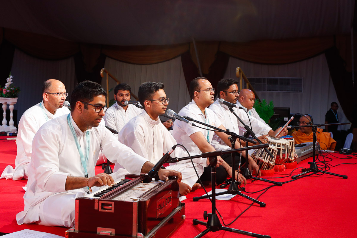 Youths sing kirtans in the evening satsang assembly