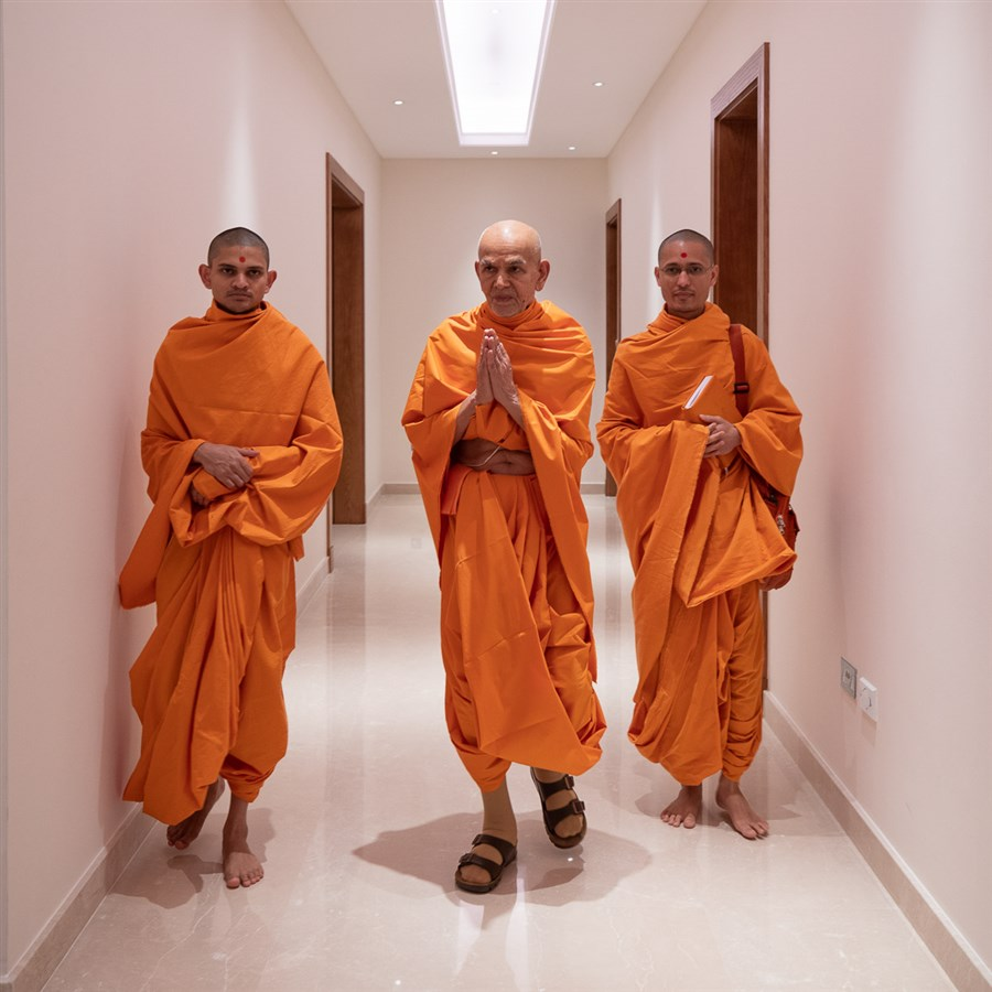 Param Pujya Mahant Swami Maharaj on his way for his morning puja