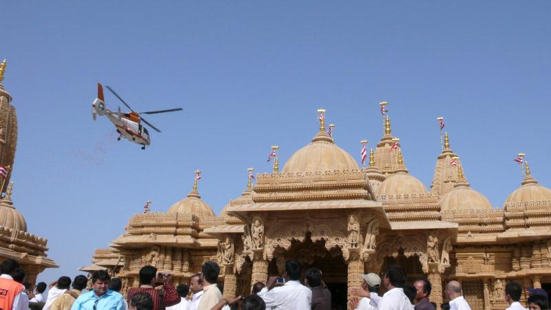 To honor the occasion flower petals were showered on the mandir from a helicopter