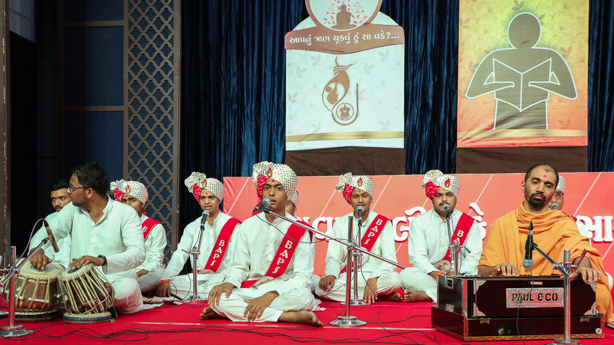 Youths sing kirtans in the YTK convocation assembly