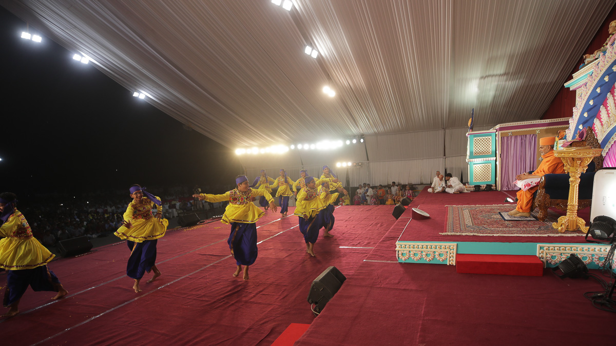 Youths perform a traditional dance in the welcome assembly