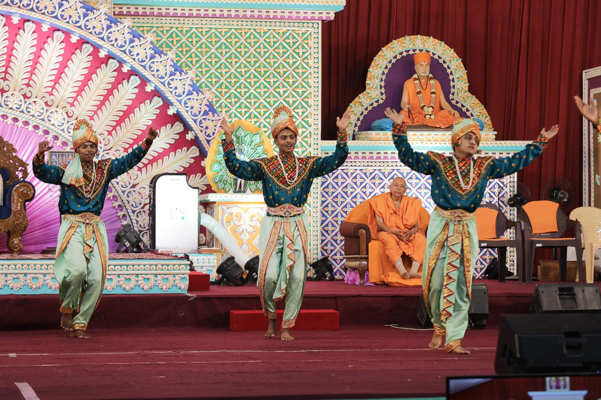 Youths perform a traditional dance in the evening satsang assembly
