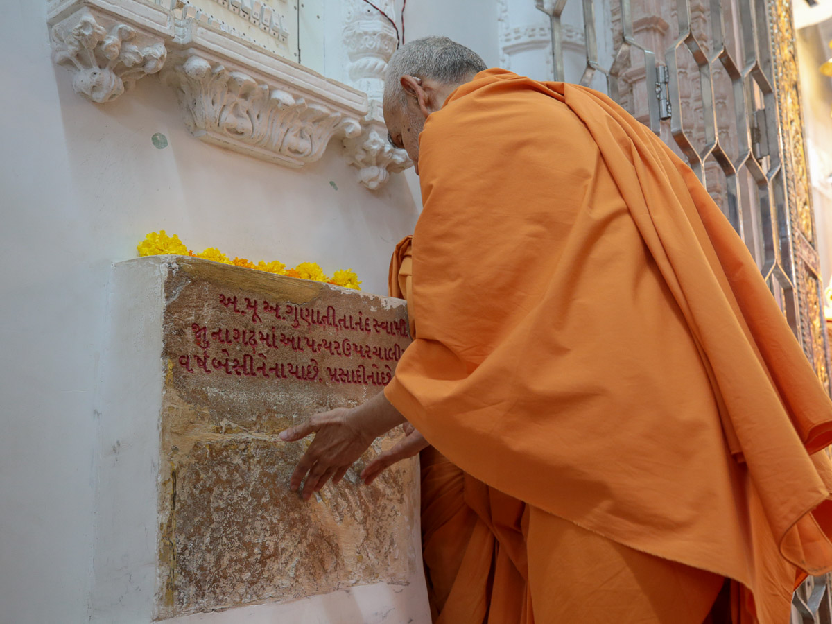 Swamishri reverentially touches the sacred stone