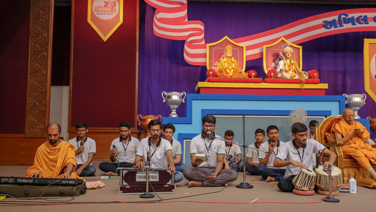 Youths sing kirtans at the start of the shibir