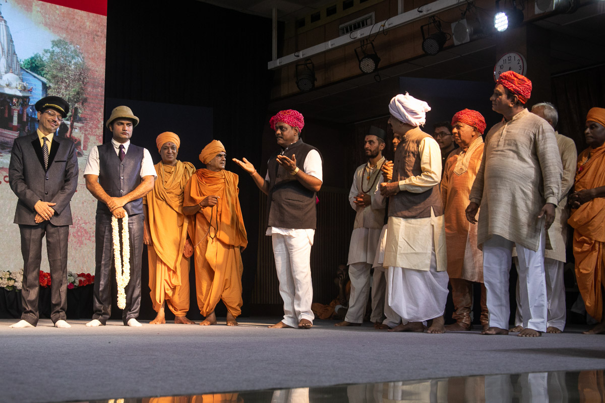 A skit presentation by youths on the history of the Swaminarayan Sampradaya in Ahmedabad in the evening satsang assembly