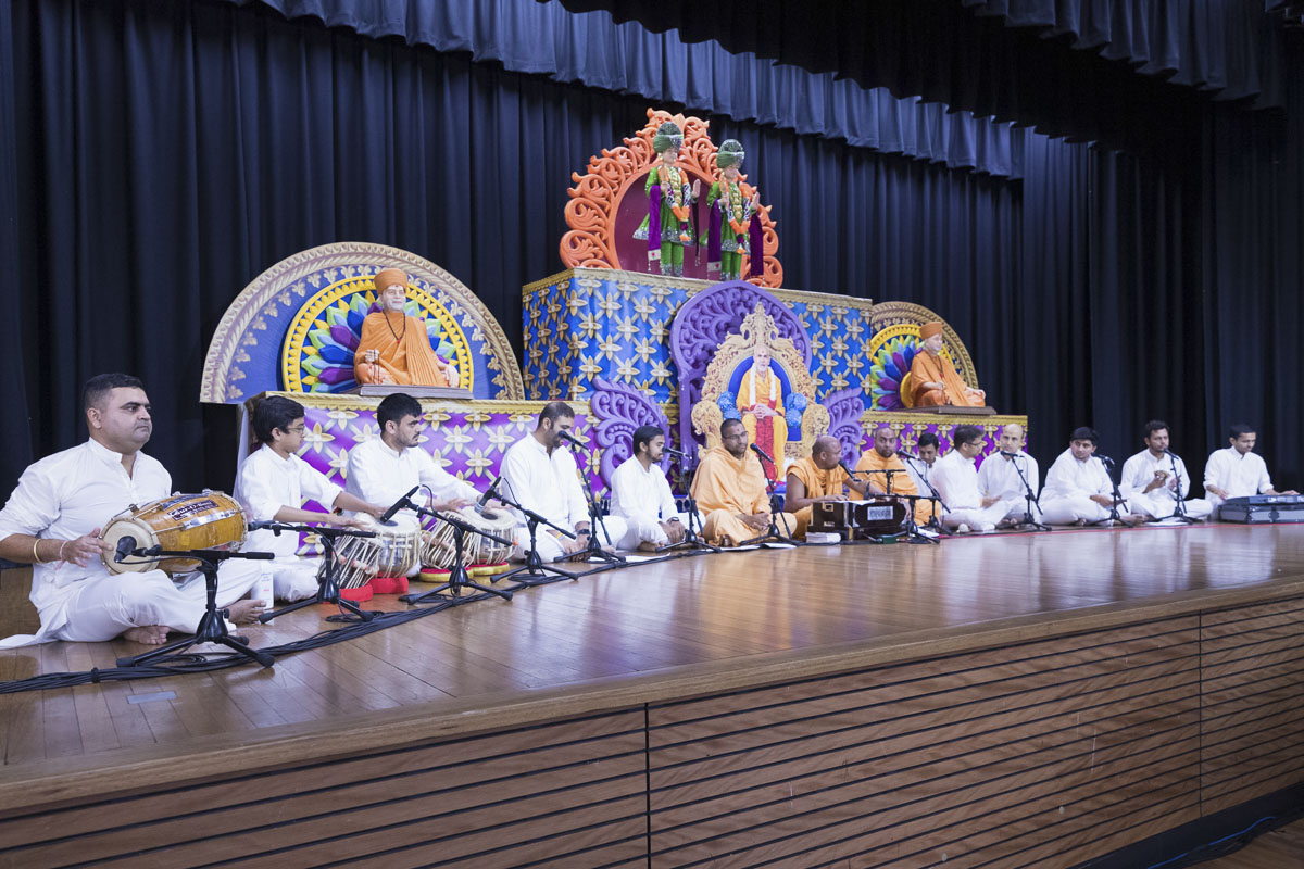 Sadhus and youths sing kirtans in the assembly