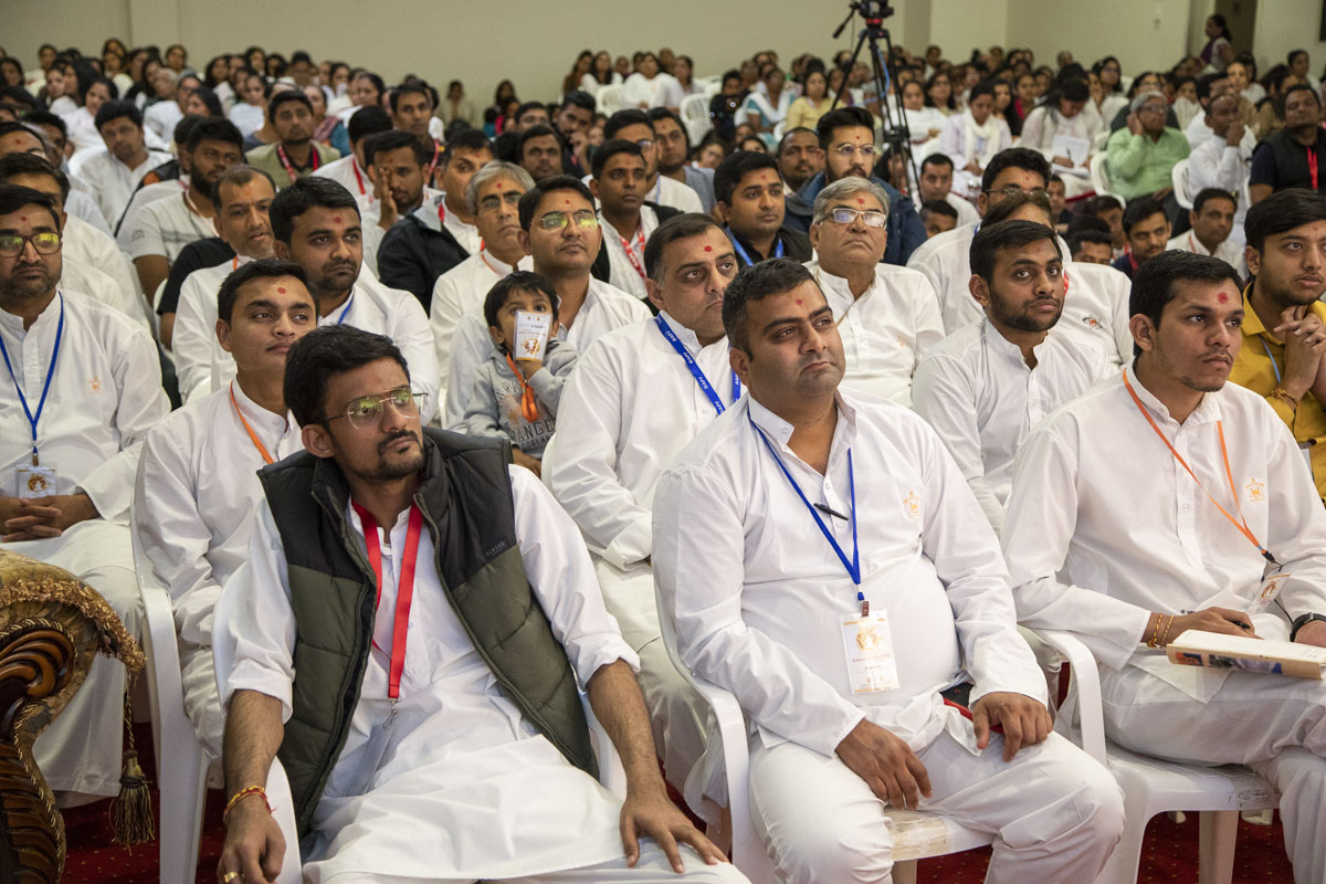 Devotees during a shibir session