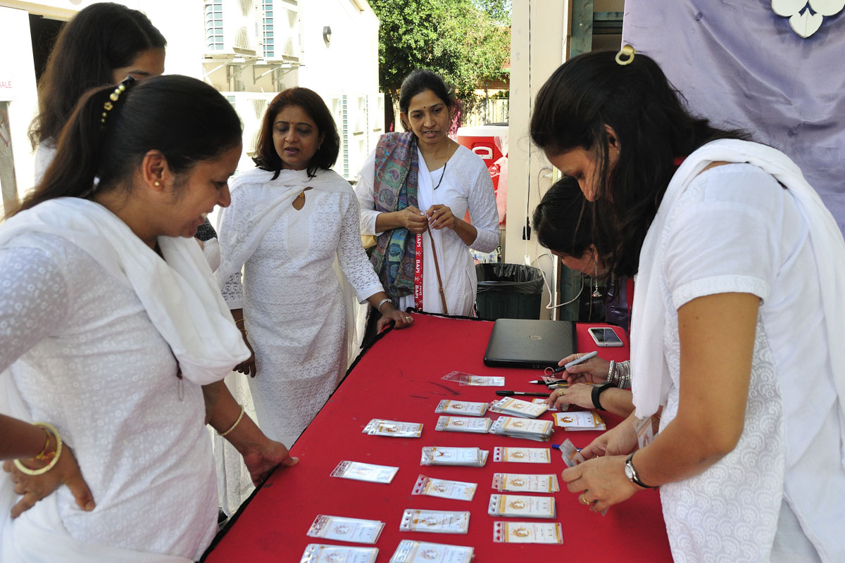 Devotees doing registration for the satsang shibir