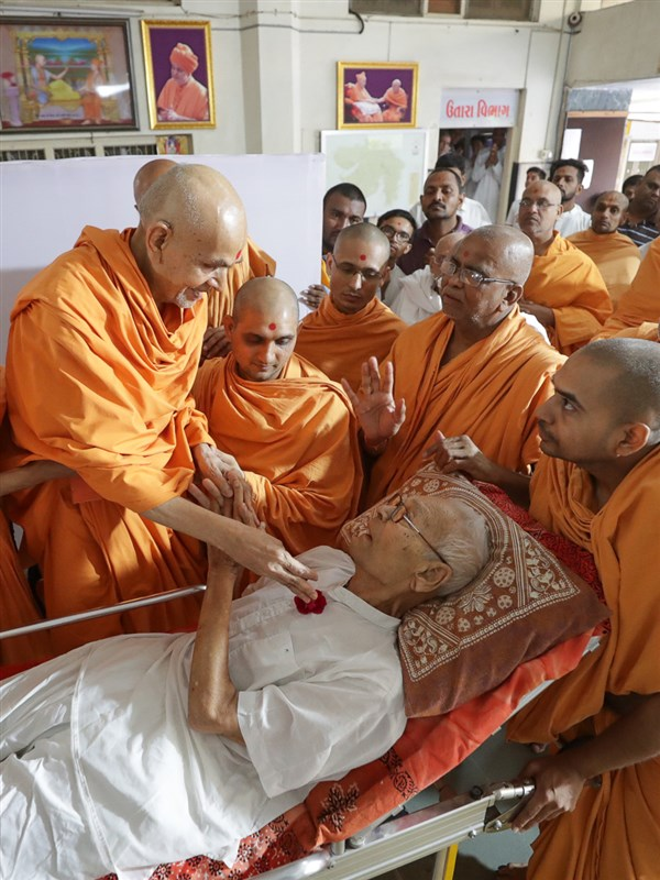 Swamishri blesses an ailing devotee