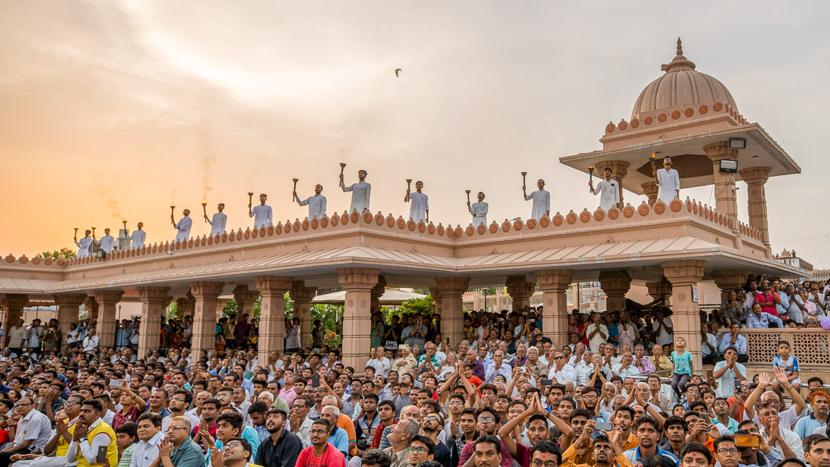 Devotees in the mandir grounds during the welcome assembly