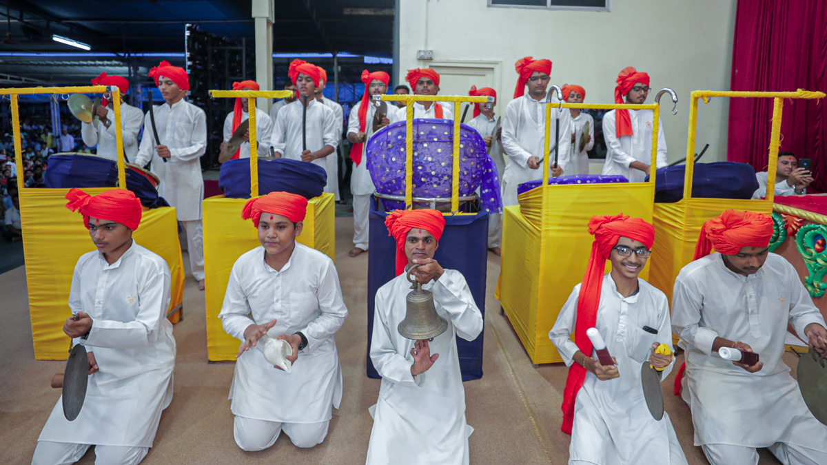 Youths play musical instruments during the arti