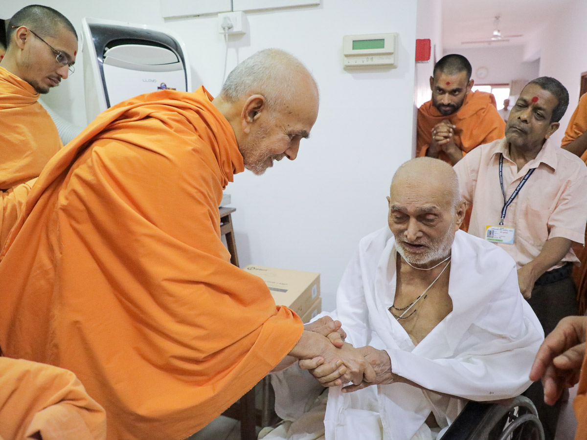 Swamishri blesses an ailing parshad