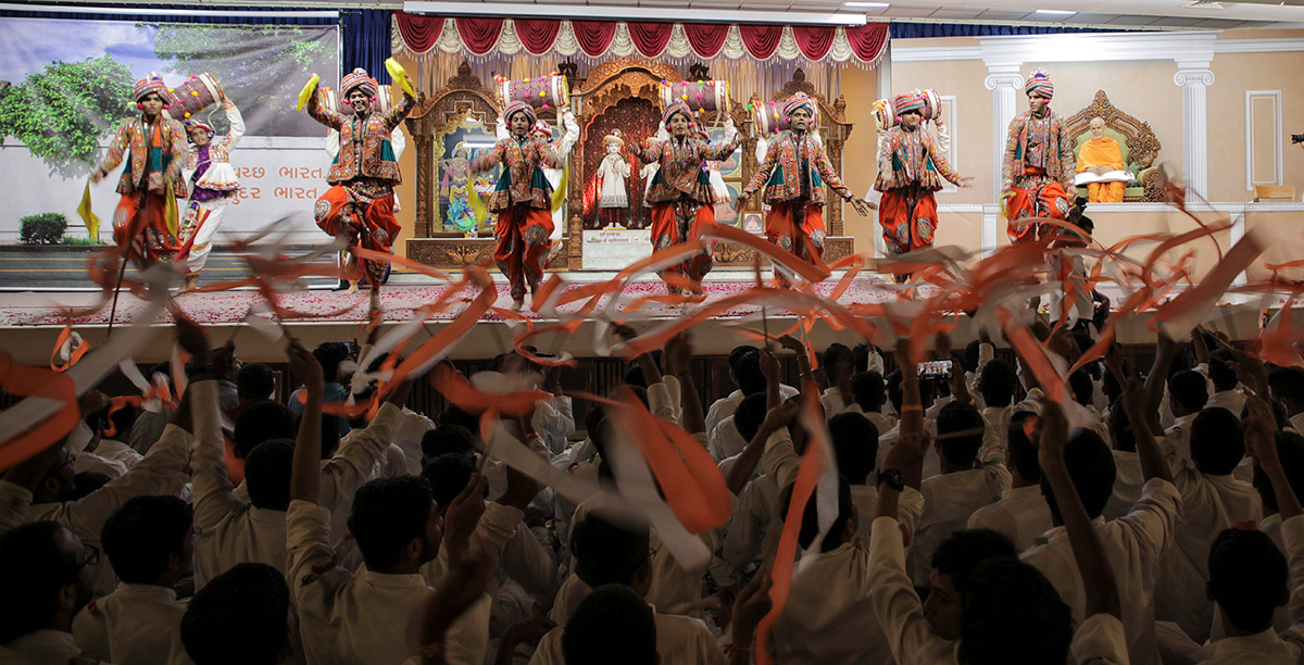 Youths perform a traditional dance in evening Yuva Din assembly