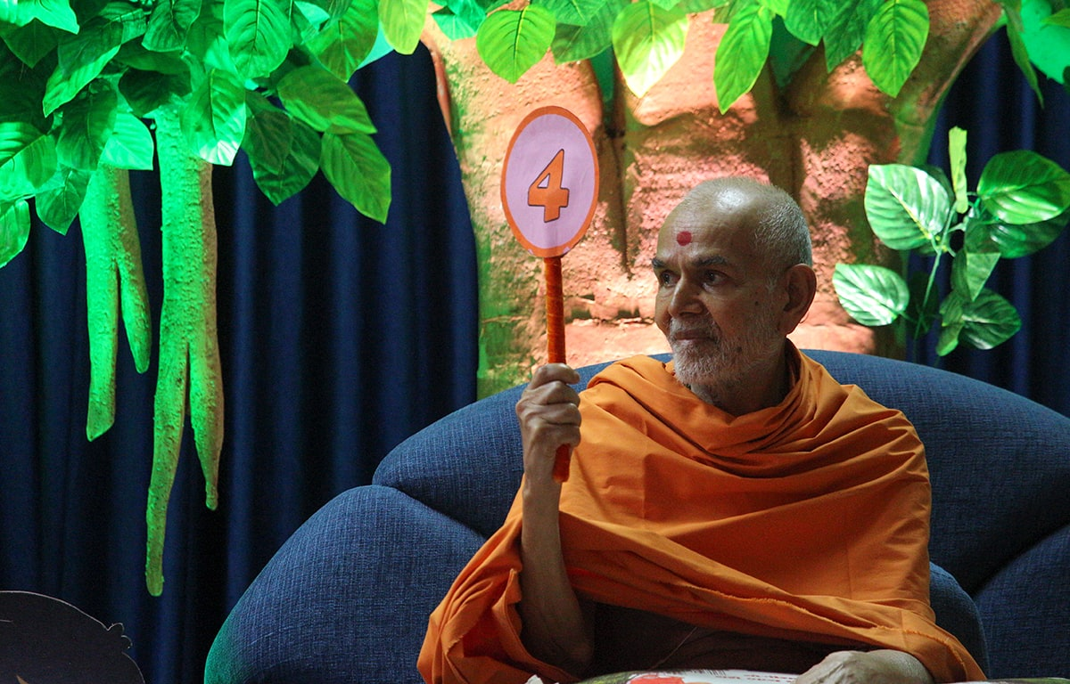 Swamishri participates in an activity