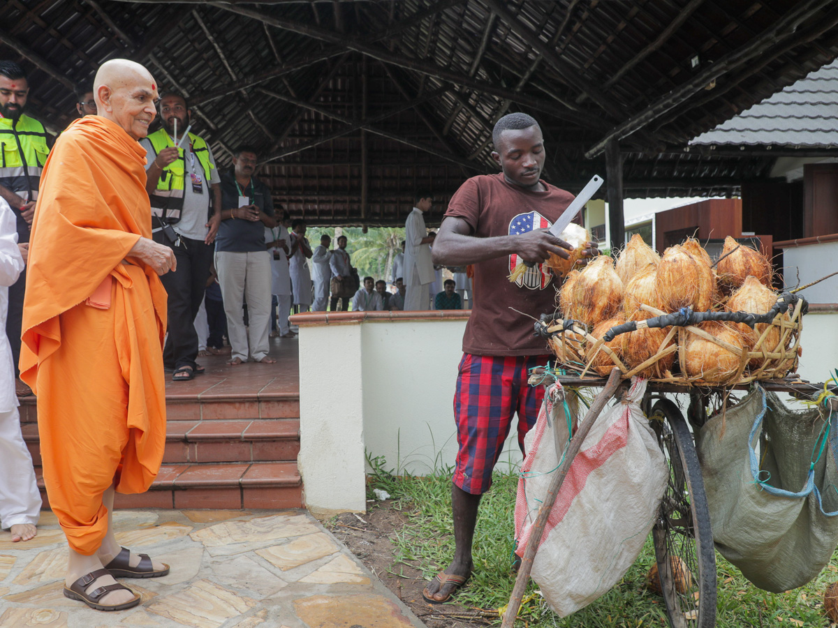 A local resident prepares the coconut