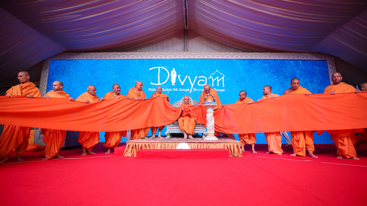 Swamishri and sadhus participate in an activity