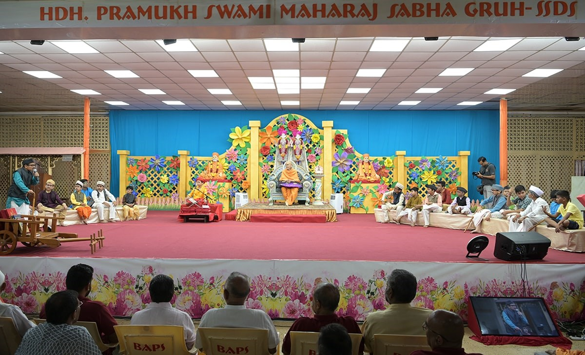 'Shastra Charcha' presentation by children in the evening satsang assembly