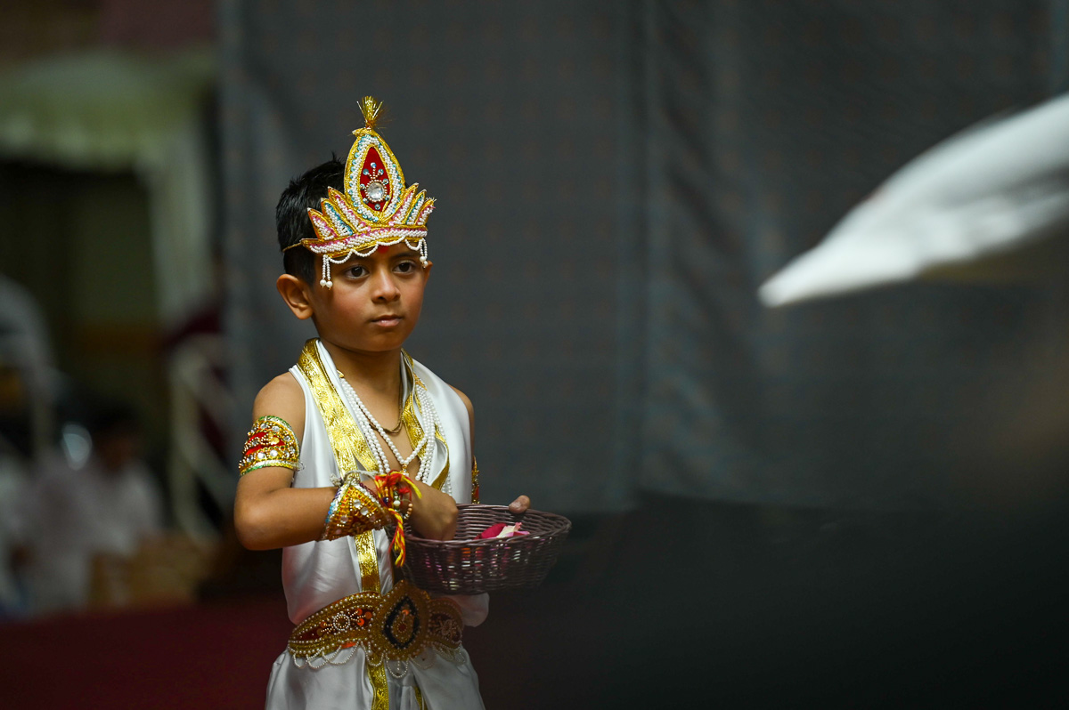 A child performs a traditional dance