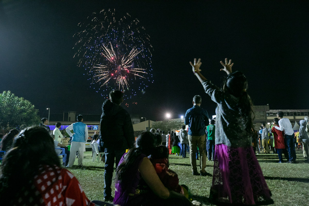 Children and devotees watch fireworks