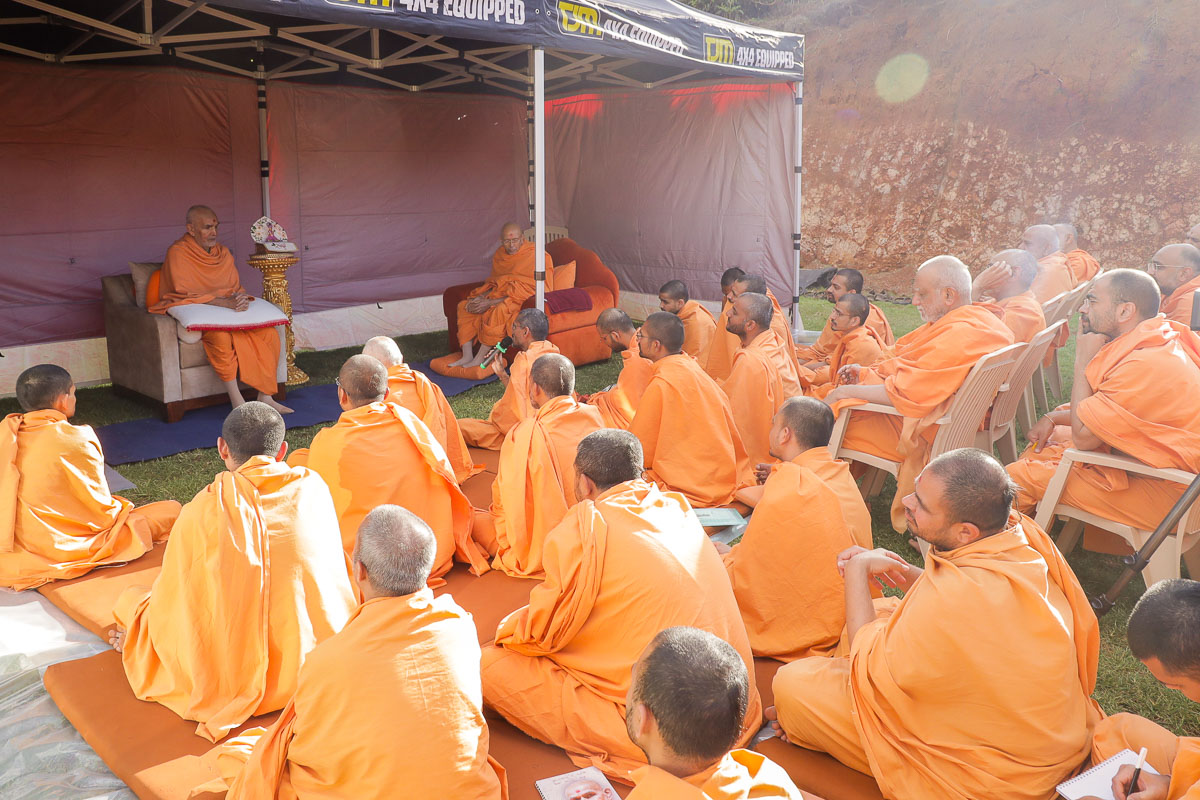 Swamishri and sadhus during the shibir