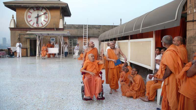 Swamishri on the mandir terrace engaged in his regular round