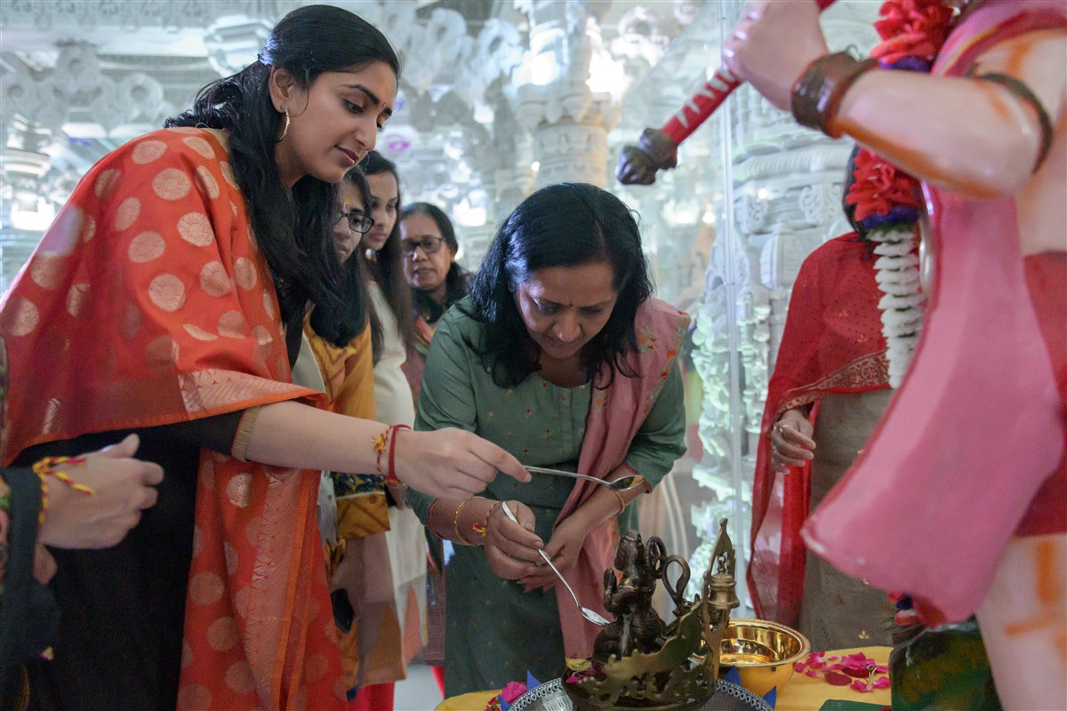 Devotees engaged in the pujan rituals