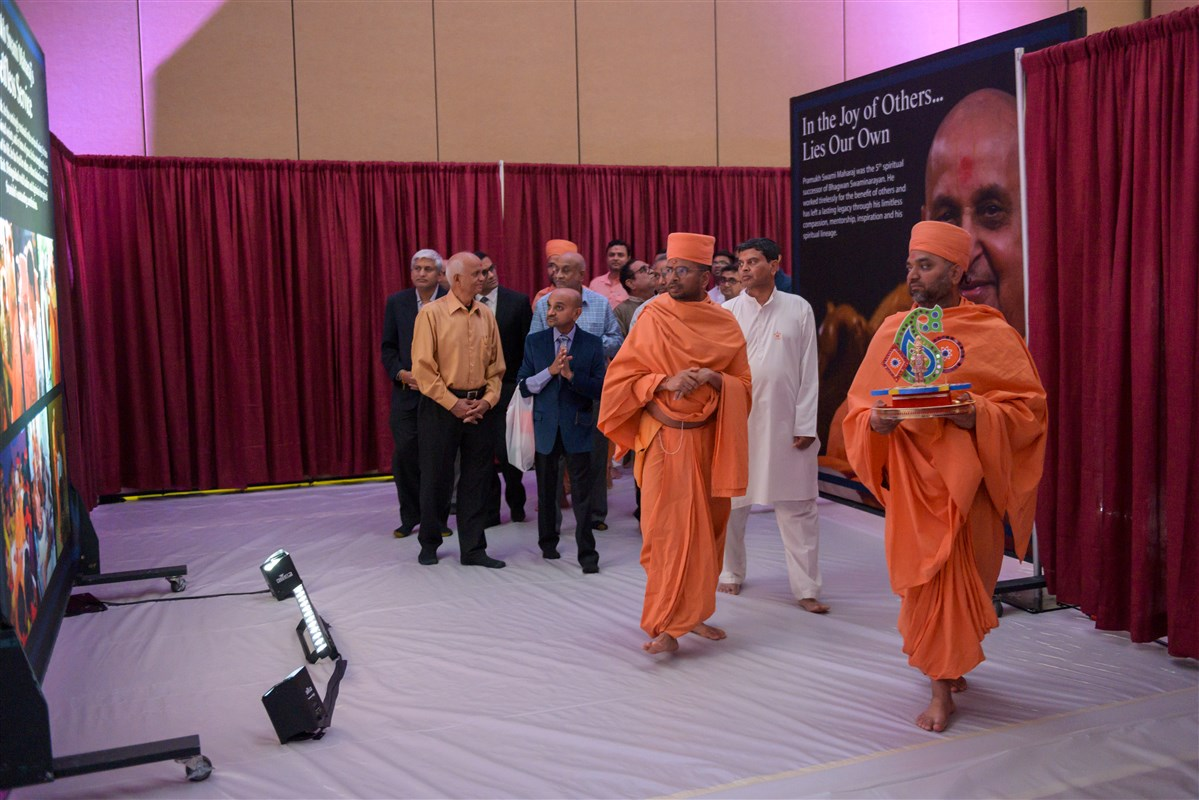 Pujya Swamis and well-wishers view the exhibition on Pramukh Swami Maharaj's Life & Work