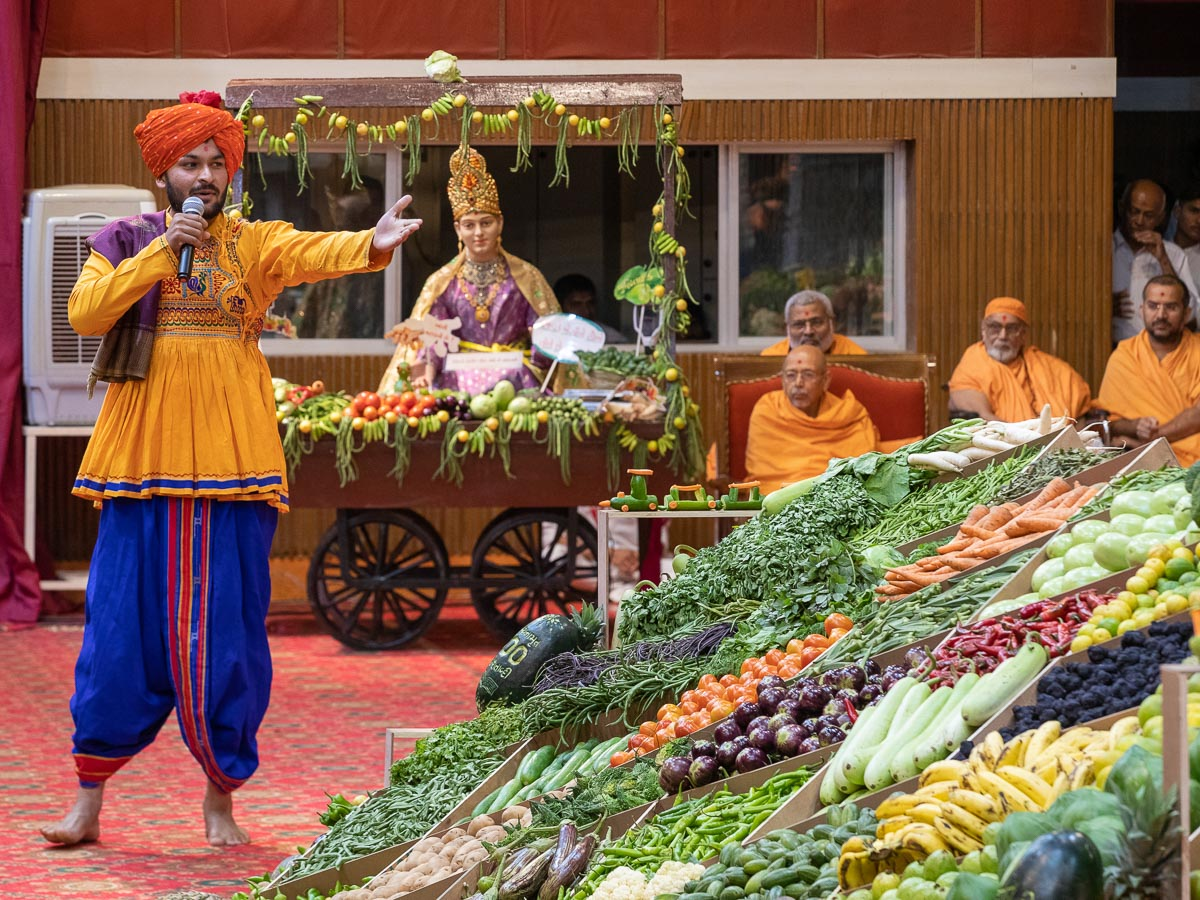 A youth presents before Swamishri