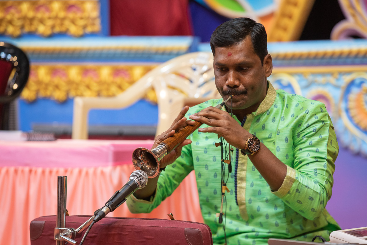 A musician plays the shehnai