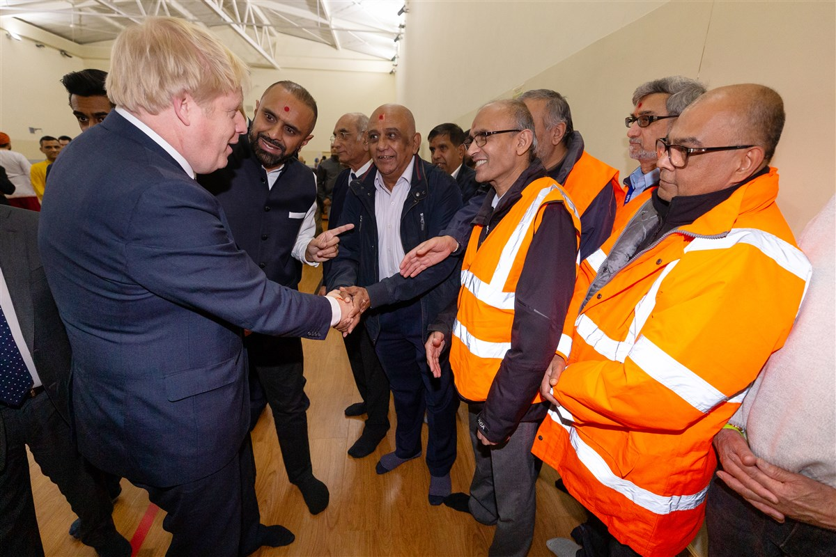 The Prime Minister met some of the volunteers who serve in the Mandir's transport department